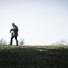 Man chimping pictures on hilltop. [Stark mix]