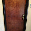 "Found this door in the hotel in Liberal, KS.  Liberal, KS is the home to Dorothy's house from Wizard of Oz.  Notice the peep hole at the bottom of the door?  We wondered if it was for the ""Munchkins""."