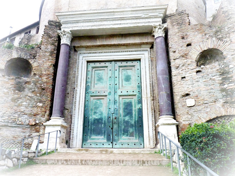 The Temple of Divus Romulus (4th Century). The doors are original (bronze) as are the porphyry columns. The Romans loved the purple-colored porphyry as a symbol of royalty. They used so much of it that none remains in the world to be quarried.