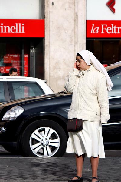 Nun on her mobile phone.