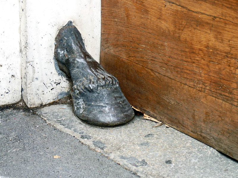 Horse hoof coming out of a wall.