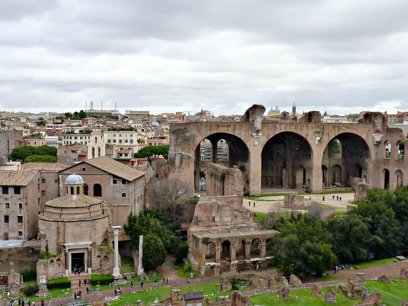 The Roman Forum viewed from Palatine Hill. Clearly seen are the Basilica of Maxentius (large arches) & the Temple of Divus Romulus (domed building in the foreground).