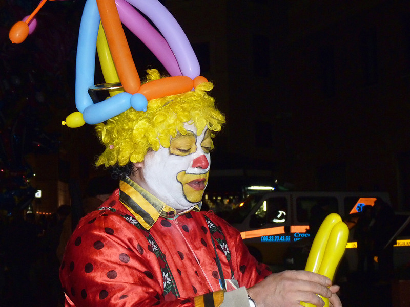 Clown entertaining children in Piazza Navona during the Festival of the Epiphany.