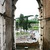 View through a Colosseum arch.