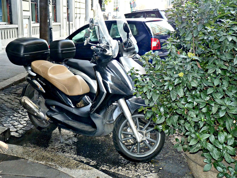 A moped parked in front of the Savoy.