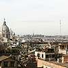 The hazy rooftops of Rome viewed from the Trinità dei Monti Church.