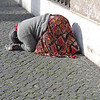 Beggar woman prostrating herself near the Vatican.