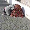 Beggar woman prostrating herself near the Vatican.