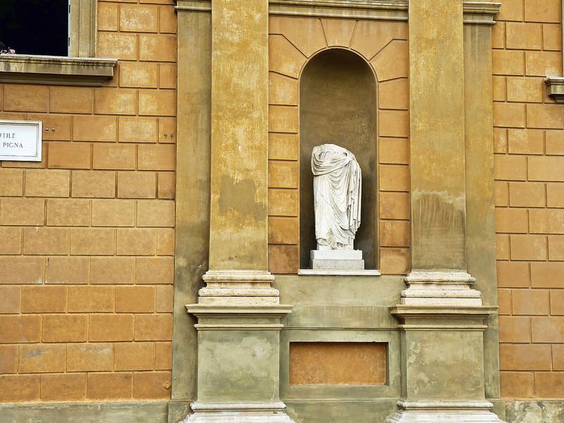 Ancient Roman statue in the Vatican's Belvedere courtyard.
