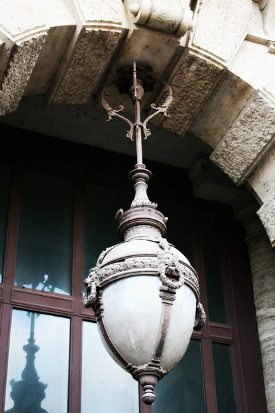 Heavy lantern hanging from the Palace of Justice in Piazza Cavour.