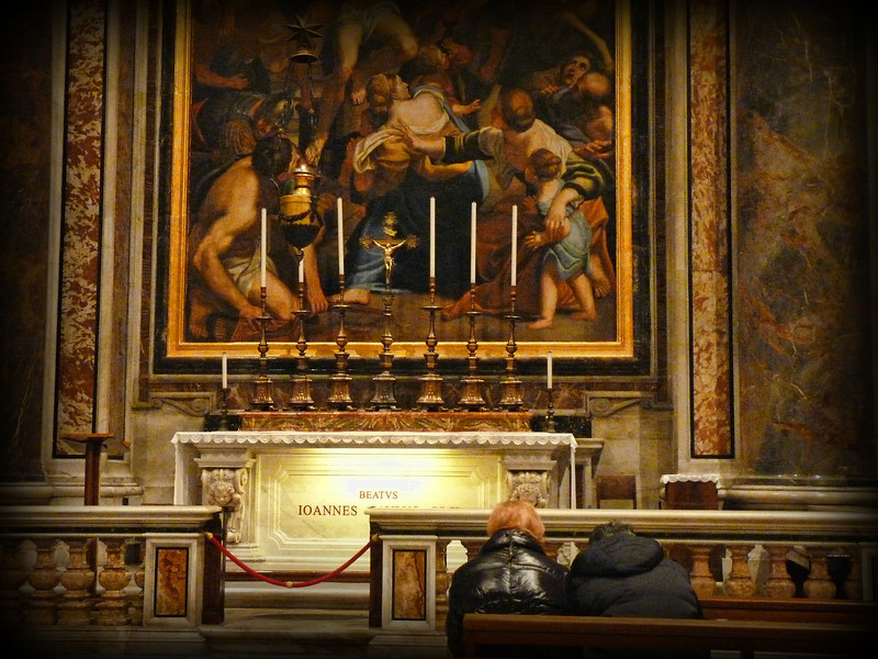 Couple praying in St. Peter's Basilica.