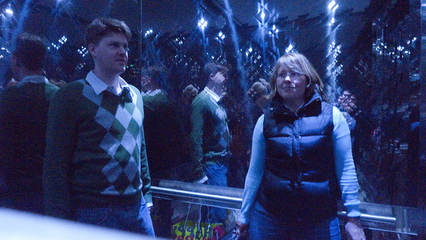 Brett and Kirsten in the elevator at the W, cool blue lighting.