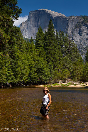 Melinda in the Tenaya Creek with the Half Dome in the background