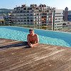 Rustem in the infinity pool atop the B-Hotel. In the background are the Venetian Towers built in connection with 1929's International Exhibition. The towers are modeled after those in Venice's St. Marks Square.