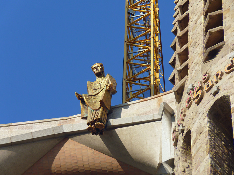 "Christ figure perched atop Sagrada Família representing the ascension of Christ.<br /> <br /> Concerning the completion of Sagrada Familia Gaudi replied, ""My client is in no hurry. God has all the time in the world""."