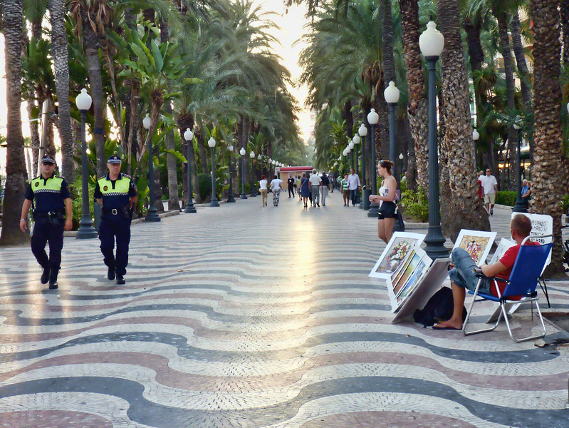 Police patrolling the beautiful Alicante promenade, Explanada de España, which is paved with 6.5 million marble floor tiles.