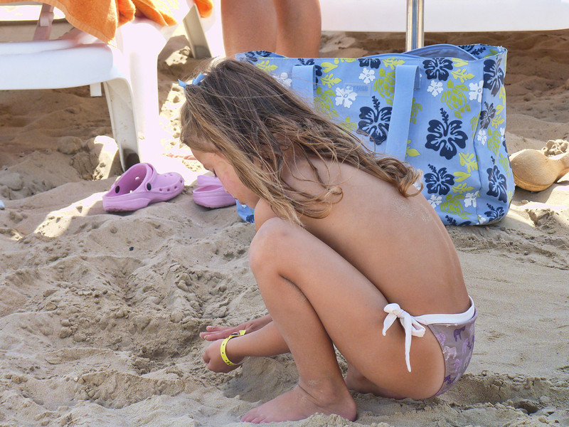 Girl playing in the sand.
