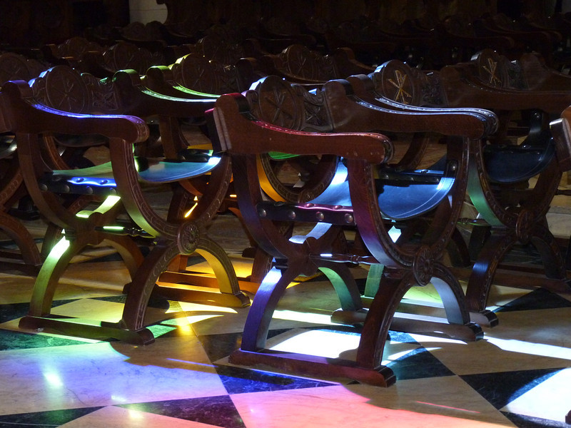 Light from the stained glass windows on the chairs in the Cathedral.