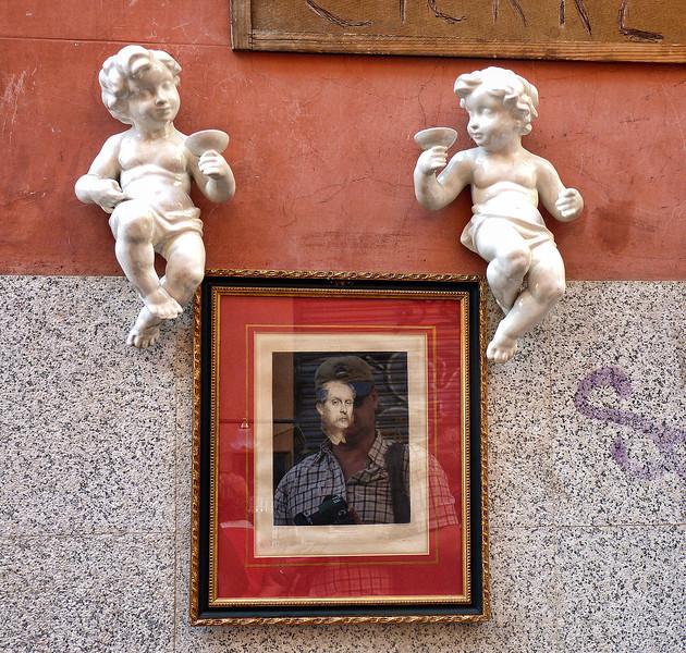 Cherubs & art for sale at El Rastro.