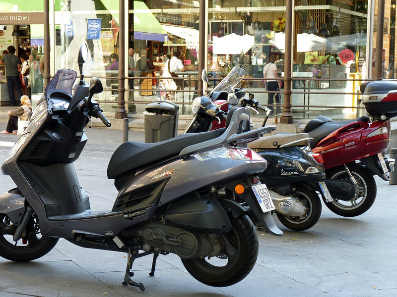 Mopeds parked outside Madrid's Mercado San Miguel.