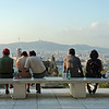 People enjoying the view from Barcelona's National Museum of Art of Catalunya atop Monjuic hill.