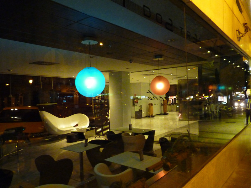 Lobby of the Paseo del Arte Hotel from the street at night.