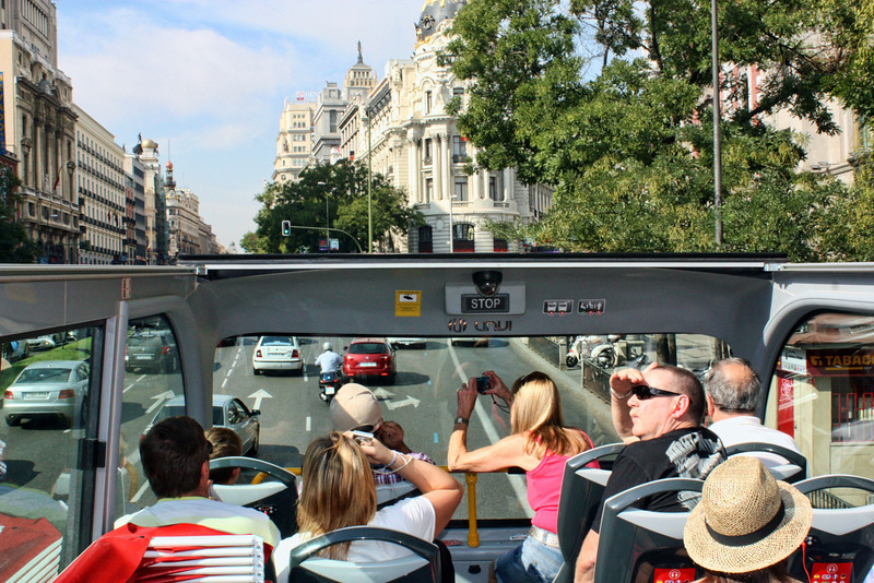 Riding the double-decker tourist bus in Madrid.