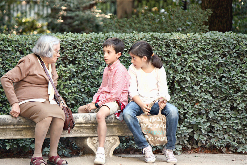 Children with their grandmother in the Botanical Gardens.