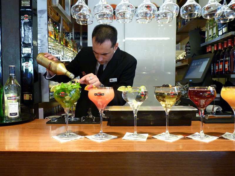 Cocktails anyone? Bartender mixing drinks in Madrid's Mercado San Miguel.