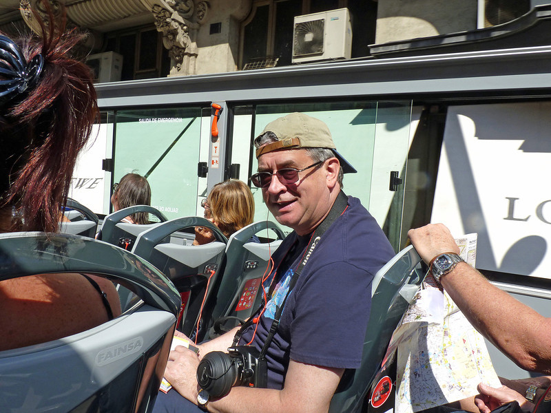 Rustem riding the double-decker tourist bus.