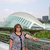 Susan at Valencia's City of Arts & Sciences. The dome covered building is The Hemisfèric.