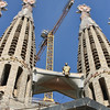 Cranes above Christ & the spires of Sagrada Familia.  Present construction is funded by the public & admissions fees.