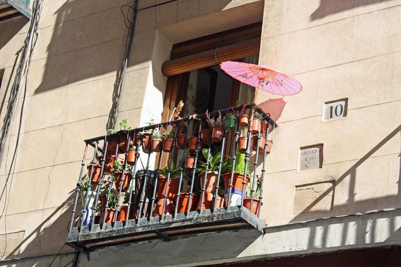 Flower pots & parasols.