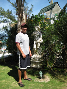 John next to naked lady statue