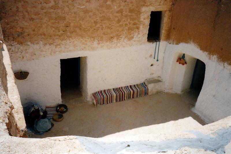 Looking down into a Berber family's courtyard. Matmata, Tunisia.