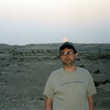 Four AM sunrisse over the Sahara. An unshaven, groggy Rustem.