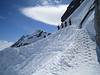 A narrow path leads to the glacier drop-in -- or, for the adventurous, you can take the chute.