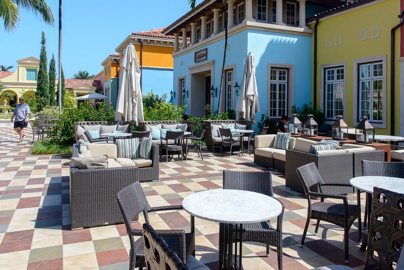 Outdoor seating in front of Cafe de Paris