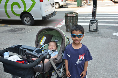 Zavier and Kieran are chillin' while someone has to go buy a new pair of sandals after a flat tire on our first block.