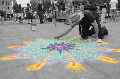 This guy was using colored sand that he sifted out of his hand to make this design. Pretty neat effect!