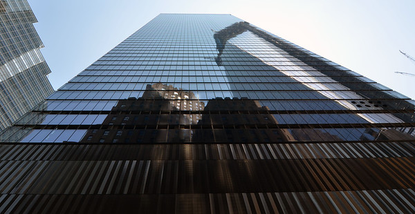 This is the reflection of 1 WTC (in construction) in the side of 7 WTC.