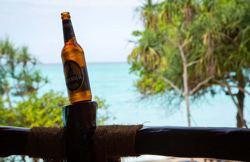 A cold beer by the ocean was the perfect way to relax after all our traveling. (Although, truth be told, Serengeti brand beer is not very good. I switched soon after.)