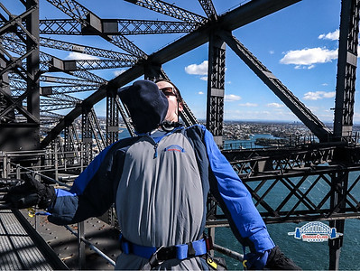 Trevor's hat blowing into his face on the top of the Sydney Harbor Bridge.