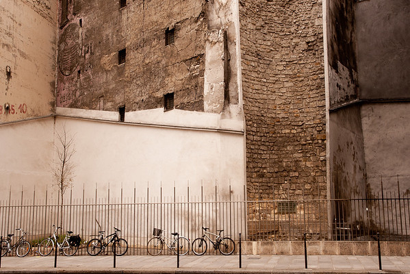 Bikes in the Marais - they seem dwarfed by the structure