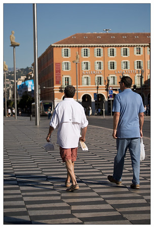 Guys carrying picnic goodies