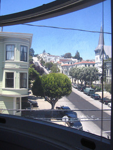 View of San Francisco through a curved window.