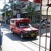 Met de taxibus de heuvel Doi Suthep op