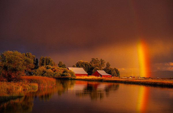Rainbow and barns on Fall River