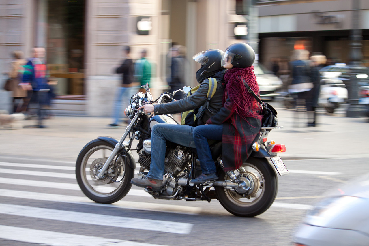 A couple riding a motorcycle near the city center of Valencia, Spain on Janurary 27, 2014.