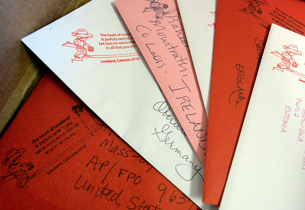 . Some of the valentines going much farther than Loveland include love being sent to Estonia, England, Ireland, Germany and to U.S. troops rest in a bin Monday, Feb. 4, 2019, during the kick off of the first day of stamping for the 2019 Loveland Valentine Remailing Program at the Loveland Chamber of Commerce in east Loveland.    (Photo by Jenny Sparks/Loveland Reporter-Herald)